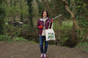 Television personality and Peak District enthusiast Julia Bradbury holds up a litter pick and reusable rubbish bag